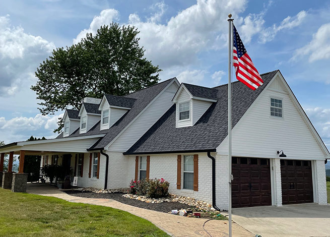 Roofer White House with American Flag